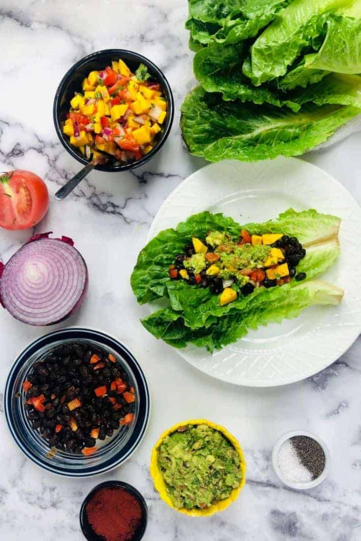 This black bean lettuce wrap recipe is darn tasty. Looking for something different for dinner? We also made a side of guacamole to go with it.  #dinner #recipeoftheday #foodie
